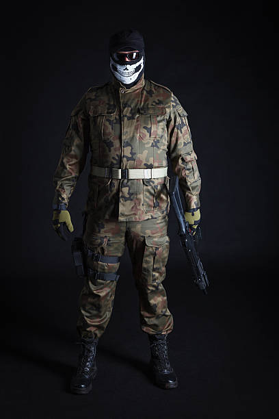 Antiterrorist standing with a gun, looking at camera Anti terrorist standing with a gun, looking at camera (studio shot) antiterrorist stock pictures, royalty-free photos & images