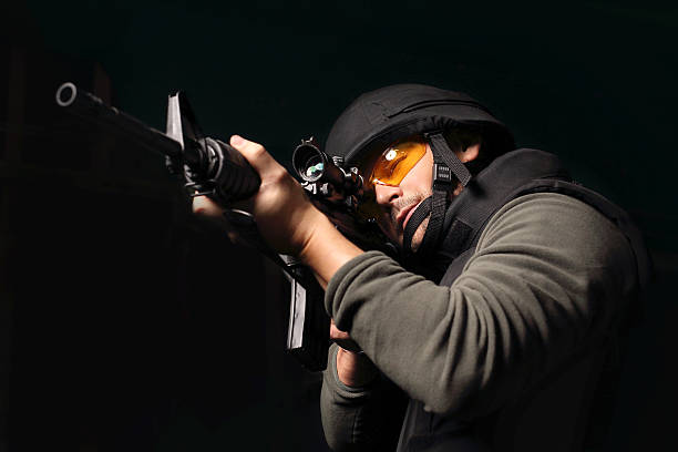 Antiterrorist. The man with a gun. Policeman of the special unit. A man with a gun wearing a bulletproof vest and helmet antiterrorist stock pictures, royalty-free photos & images