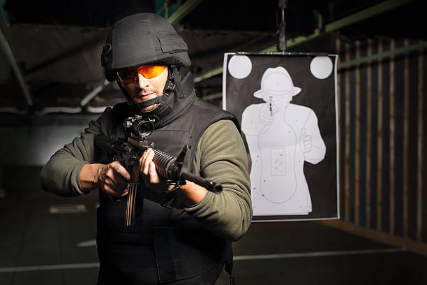 Antiterrorist. The policeman of the special unit. Man with a gun wearing a bulletproof vest and helmet antiterrorist stock pictures, royalty-free photos & images
