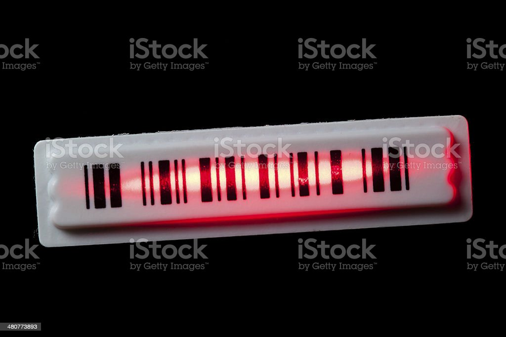 anti-theft barcode sticker with laser ray stock photo