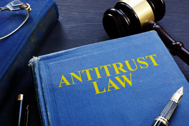 Antitrust law book and gavel on a desk. stock photo