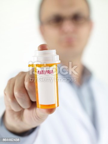 pharmacist giving a box of Antiviral pills