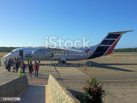 People are boarding an Antonov AN-158 aircraft on a clear blue sky day at the international airport in Santiago de Cuba in Cuba January 2,2017