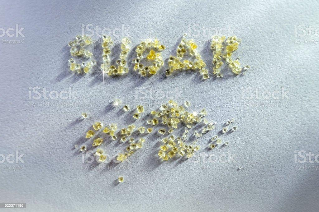 ants eating sugar on marble table zbiór zdjęć royalty-free