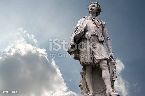 """Statue of the famous Flemish Painter Sir Anthony Van Dyck  (1599-1641) in Antwerp along the """"Meir"""", one of the main shopping streets in Antwerp."""