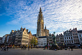 Brabo's Monument (Brabomonument) and The Cathedral of Our Lady in Antwerp, Belgium.