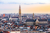 Aerial high angle view landscape of Antwerp cityscape with cathedral of Our Lady, Antwerpen Belgium sunset. EU Begium city landmark for tourism and travel destination.