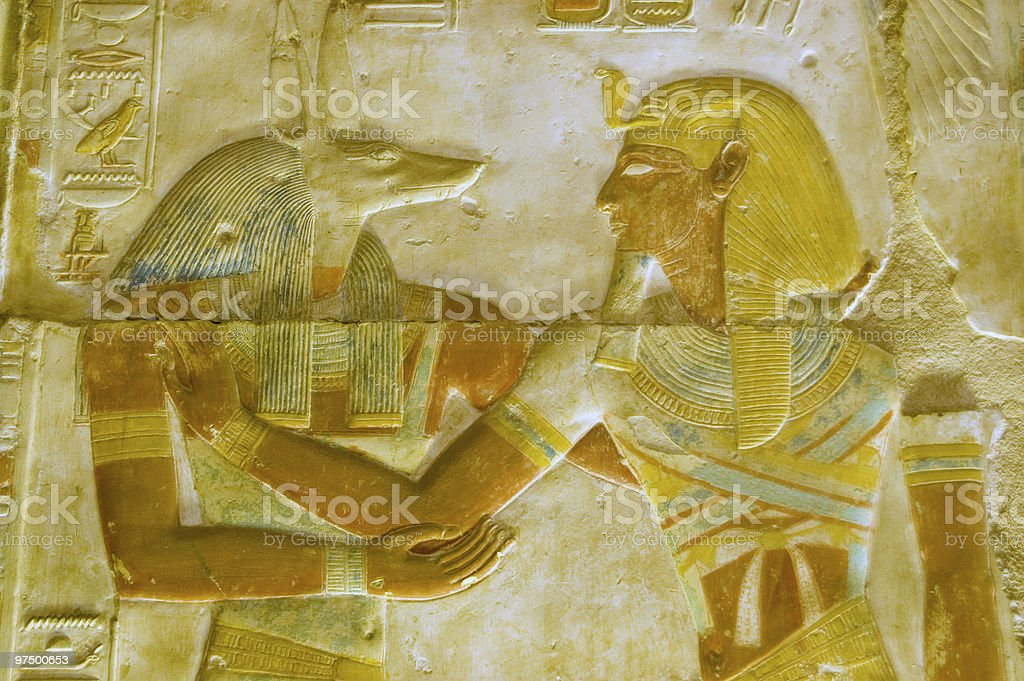 Anubis and Pharoah Seti carving royalty-free stock photo