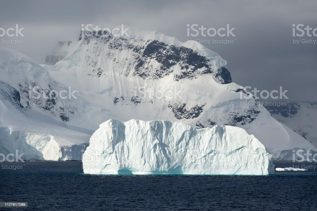 Anvers Island mountain glacier iceberg Gerlache Strait Antarctica stock photo