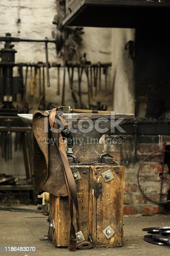 istock Anvil, hammer and leather apron 1186483070
