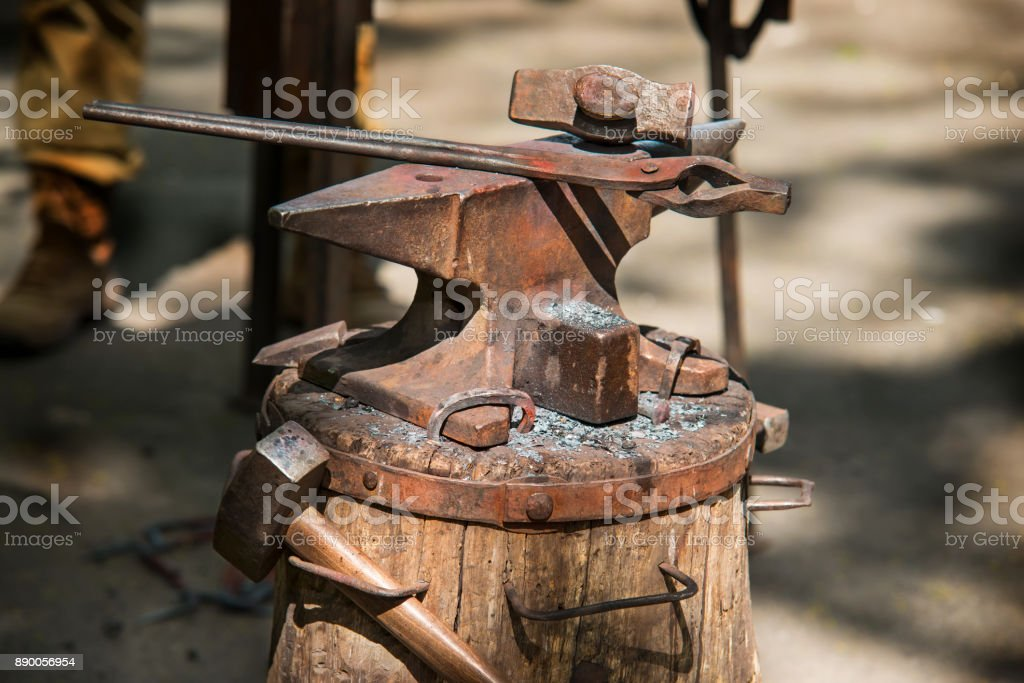 anvil of a blacksmith with tools in the open air stock photo