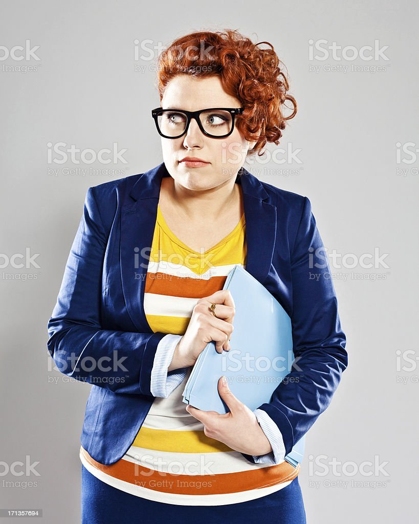 Anxiety Portrait of scared young businesswoman looking away. Studio shot, grey background. 25-29 Years Stock Photo