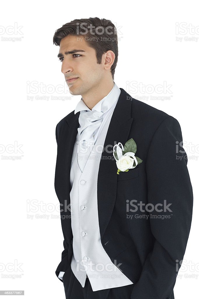 Anxious attractive young groom looking away stock photo