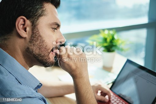 istock Anxious Businessman Biting Nails Working With Laptop Computer In Office 1133483340