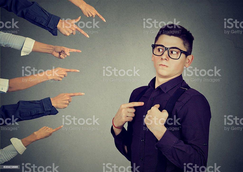 Anxious man judged blamed by people pointing fingers at him - Foto de stock de Abuso libre de derechos