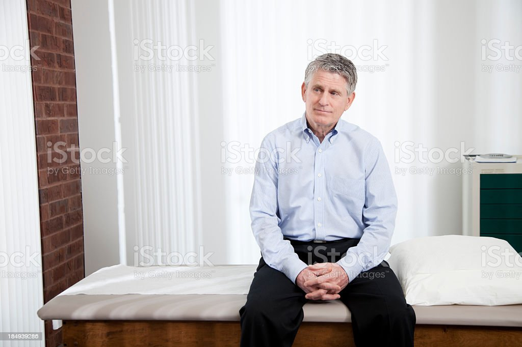 Anxious patient sitting, waiting for Doctor royalty-free stock photo