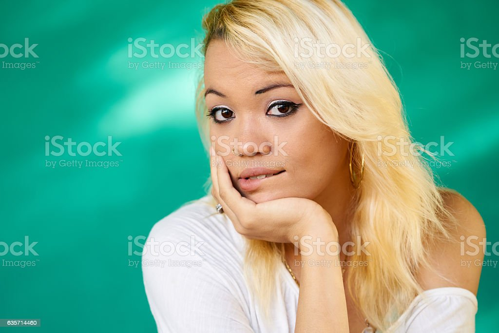 Anxious People Portrait Latina Girl Biting Lips royalty-free stock photo
