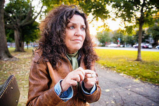 istock Anxious senior woman in crisis outdoors in park on an outdoors afternoon 1008161646