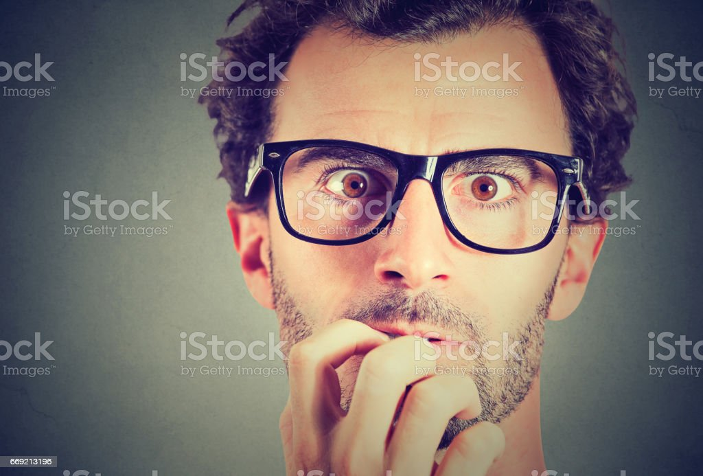 Anxious stressed young man looking at camera stock photo