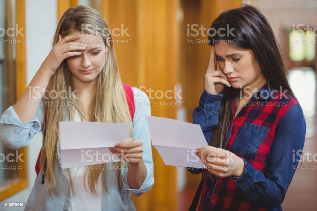 Anxious students looking at results stock photo