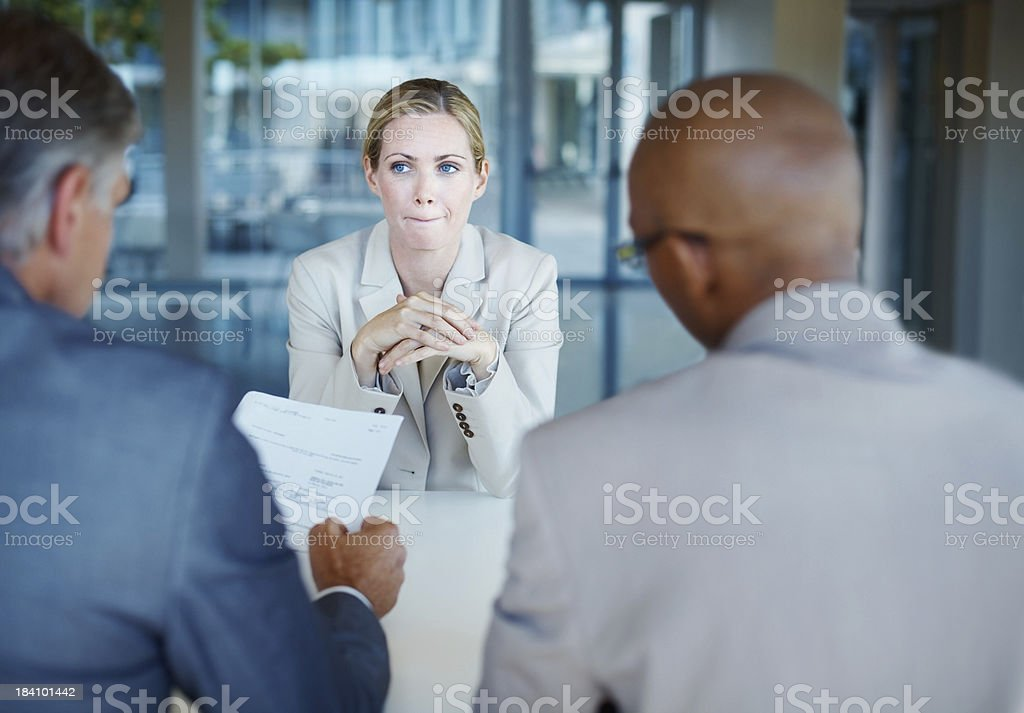 Anxious woman during business interview stock photo