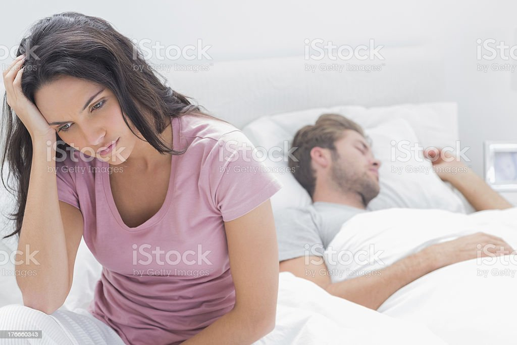 Anxious woman thinking in her bed royalty-free stock photo