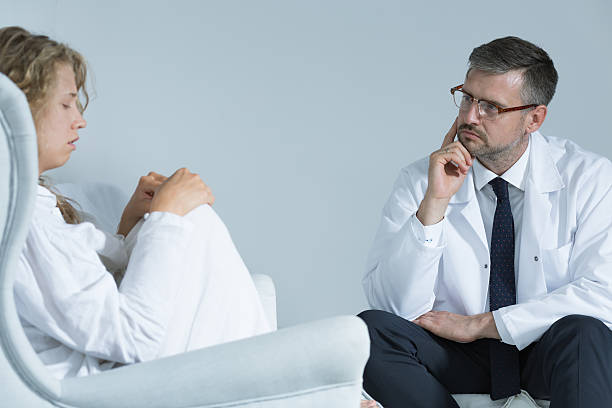 anxious woman with a psychiatrist - psychiatric ward stock photos and pictures