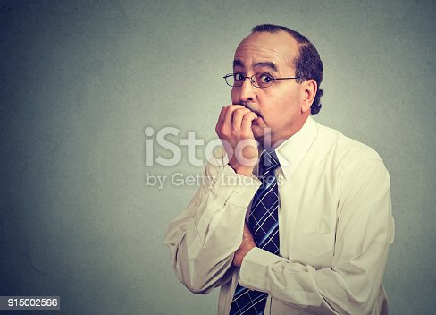 istock Anxious worker biting nails 915002566