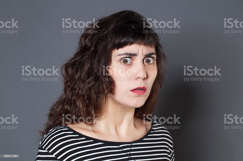 anxious young brunette woman looking terrified stock photo