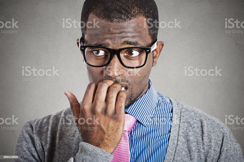 Anxious young business man looking away stock photo