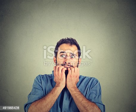 istock Anxious young man biting his nails fingers freaking out 491965428