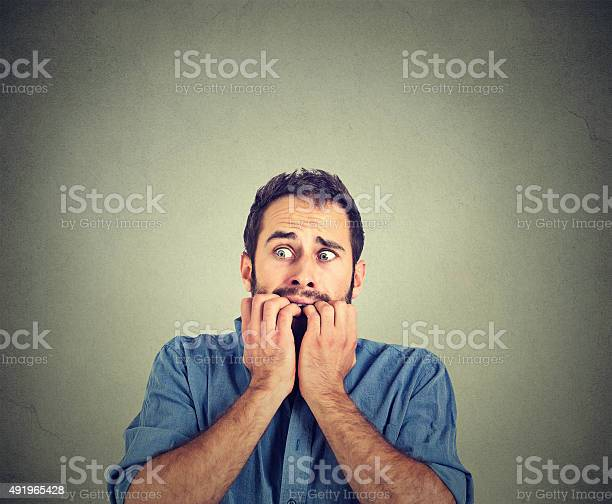 Anxious Young Man Biting His Nails Fingers Freaking Out Stock Photo - Download Image Now