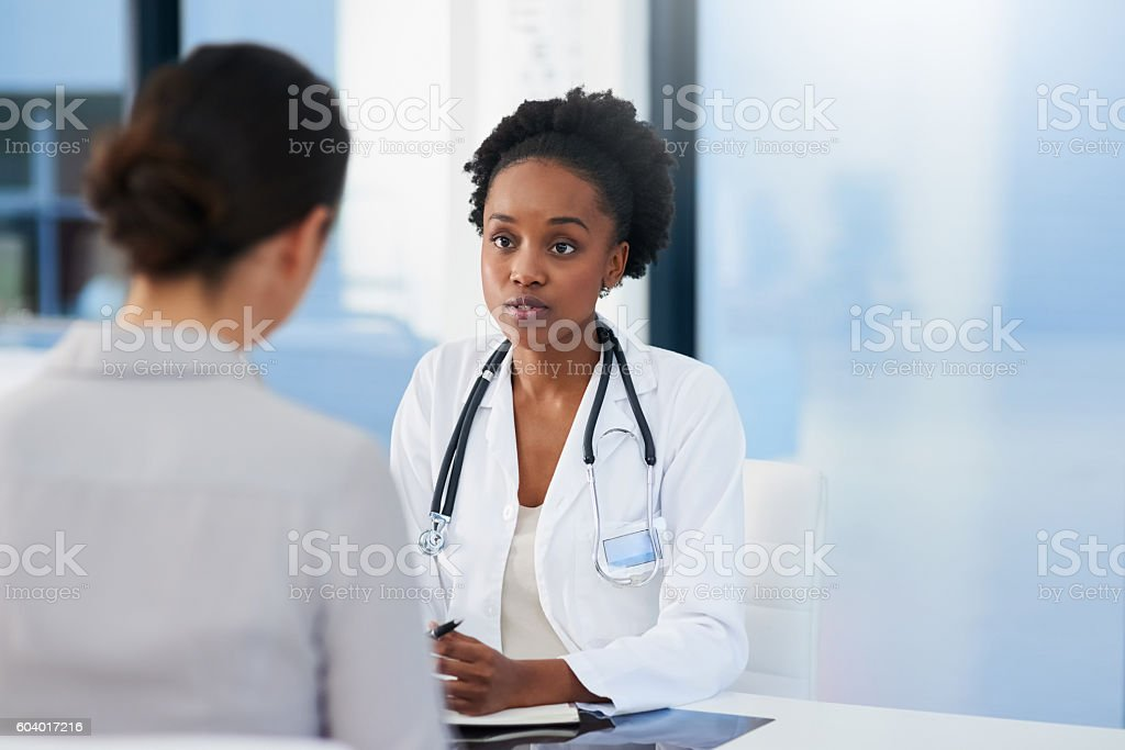 Any symptoms I should be aware of? stock photo