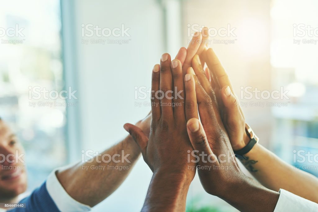 Anything is possible if we stick at it together - foto stock