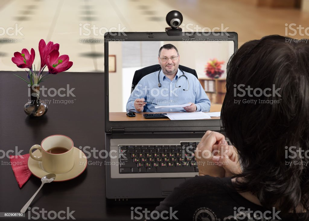 Anytime woman can contact her doctor via internet stock photo