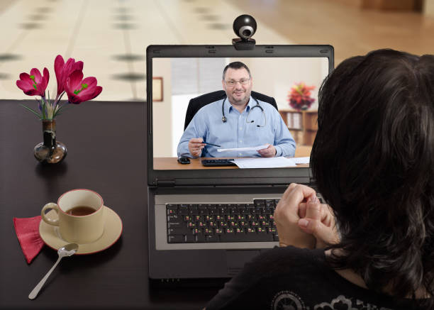 anytime woman can contact her doctor via internet - telemedicine stock pictures, royalty-free photos & images