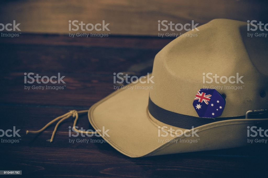 Anzac army slouch hat with Australian Flag on vintage wood background stock photo