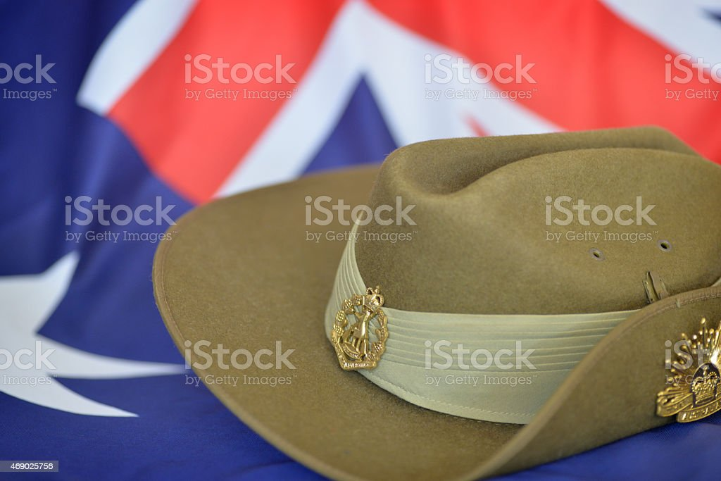 Anzac Day slouch hat in front of an Australian flag stock photo