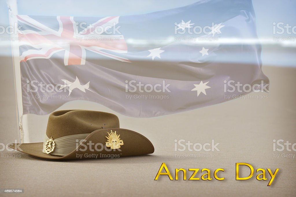 Anzac Day slouch hat on beach with Australian flag stock photo