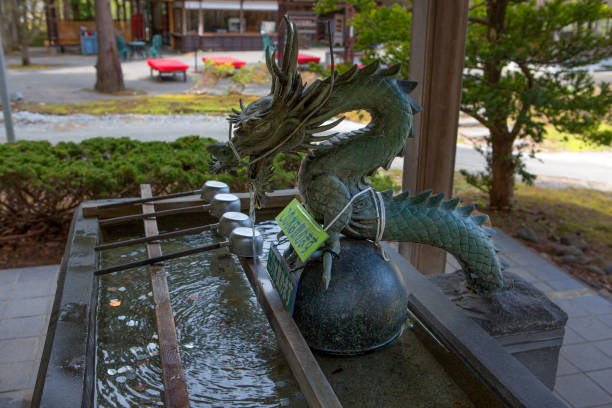 aomori, japan, hand-washing pool in shinto temple. - handwashing stock photos and pictures