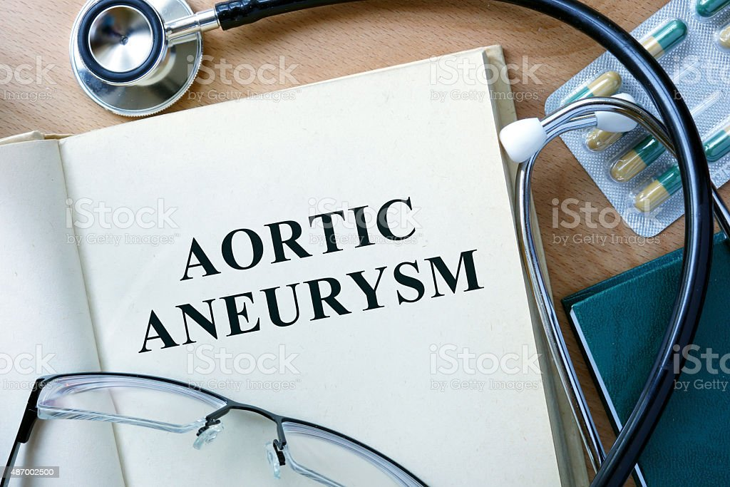 Aortic aneurysm concept. Book with stethoscope and pills. stock photo