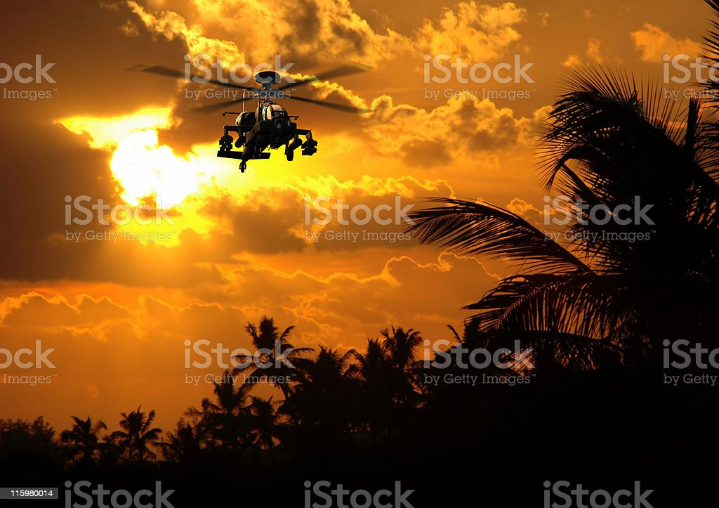 USA Apache helicopter at sunset stock photo