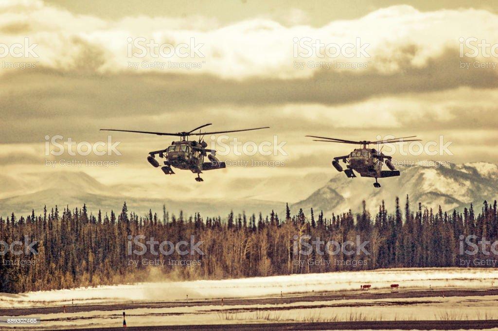 Apache Helicopter Landing in Alaska stock photo