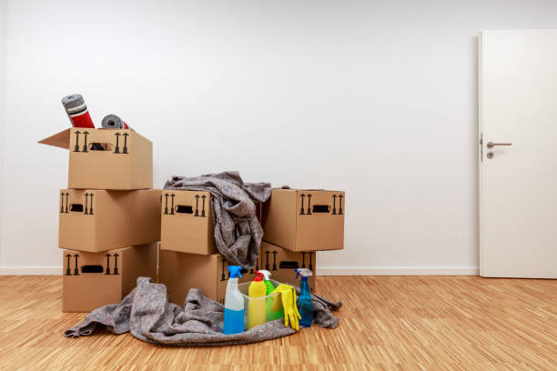 Apartment after moving in with fully packed moving boxes stock photo