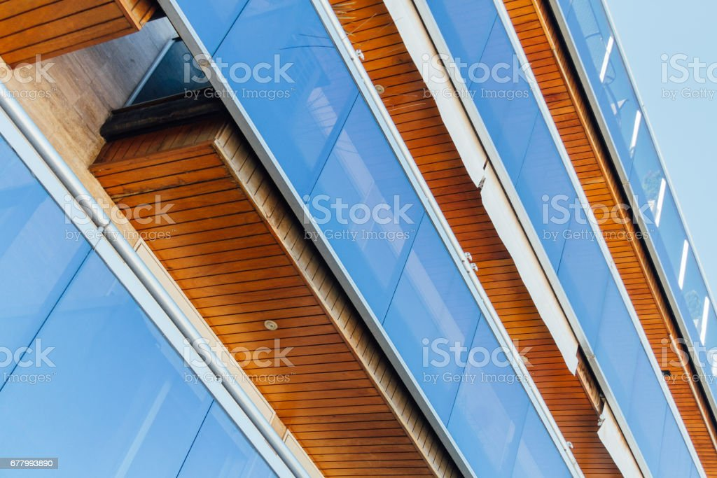 Apartment balconies with blue glass and wooden ceiling