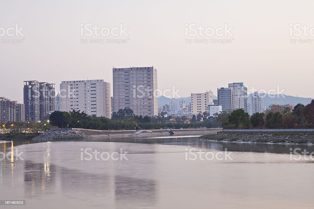 Apartment blocks at river side royalty-free stock photo