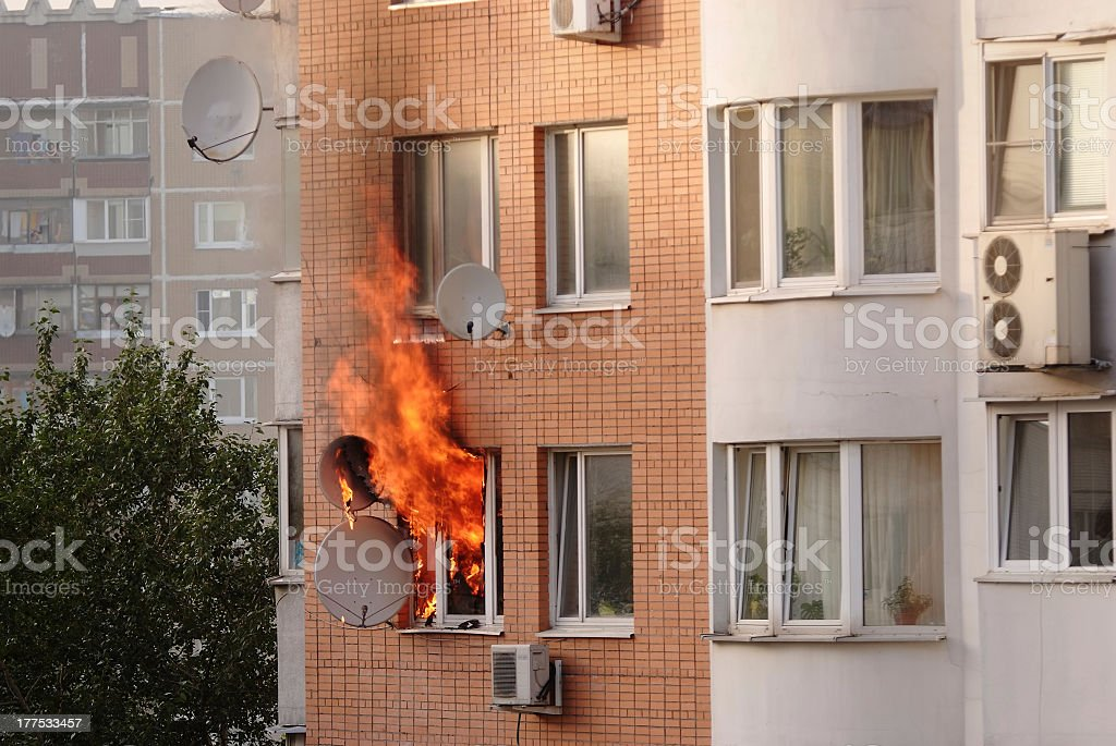 Apartment building engulfed in flames royalty-free stock photo