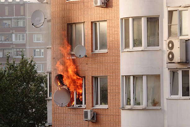 Apartment building engulfed in flames stock photo