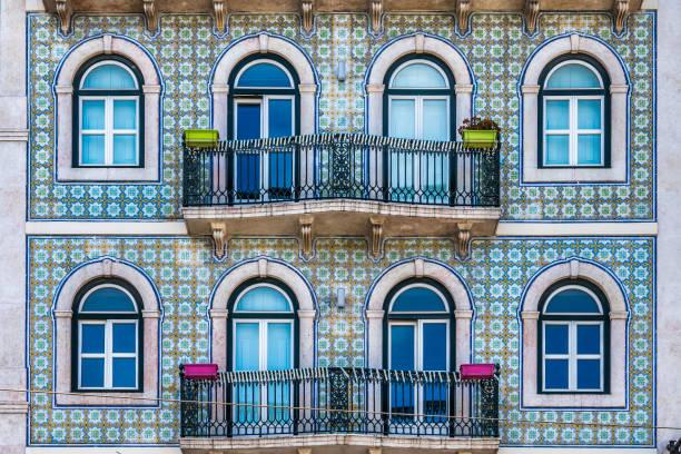 apartment building facade in lisbon - lisbona foto e immagini stock