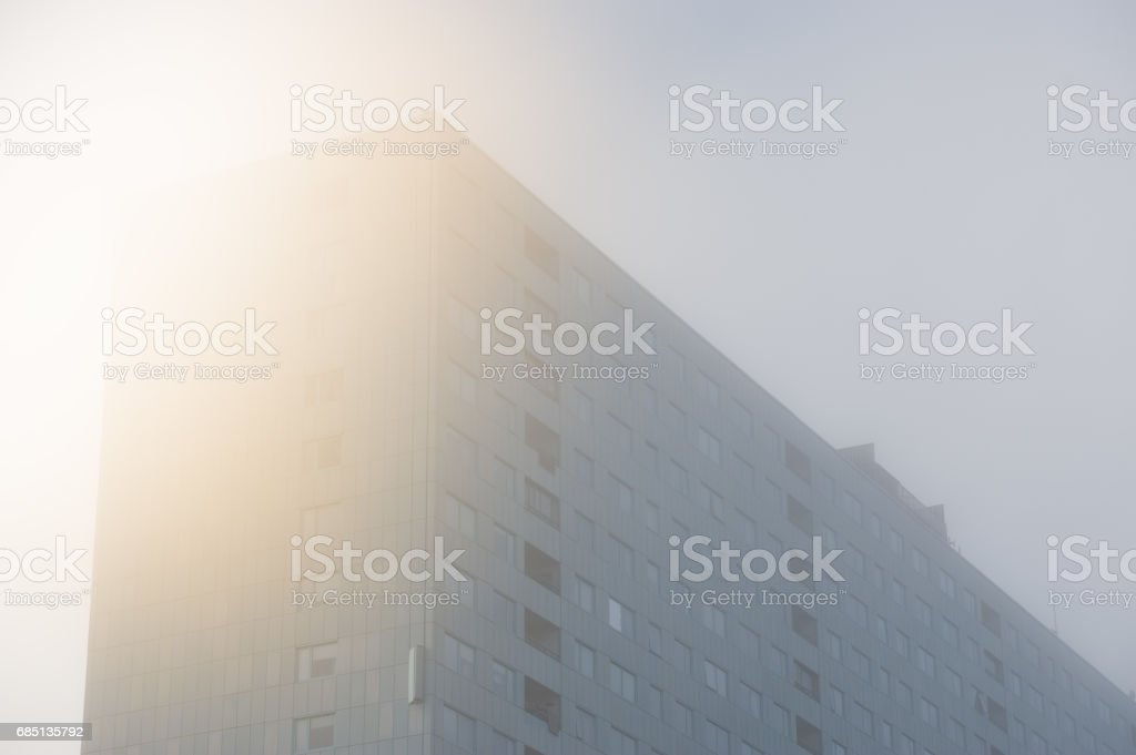 Apartment building in fog royalty-free stock photo